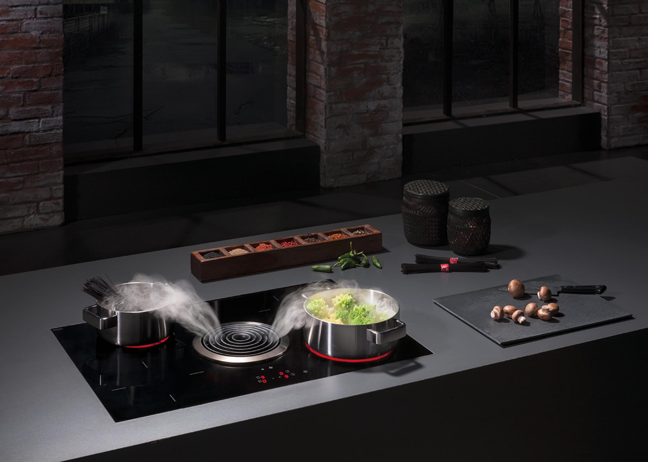 intérieur de cuisine ultra chic et épurée système aspirant pour vapeurs de cuisson BORA