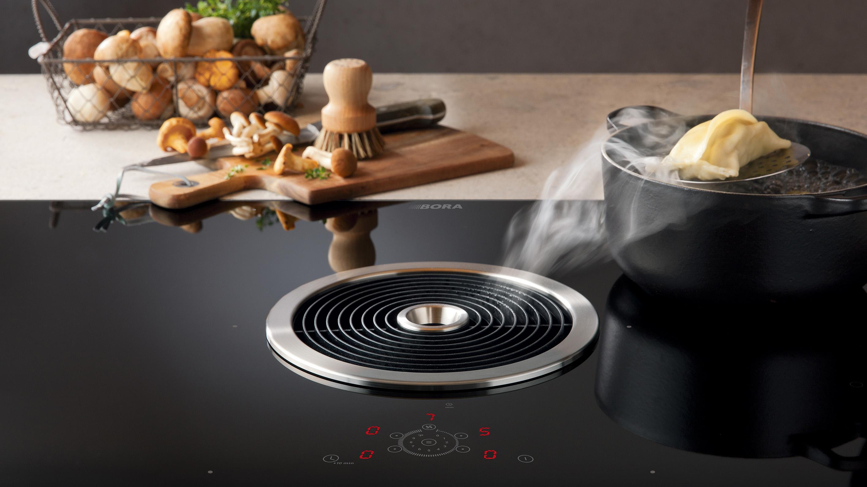 Hotte aspirante centrale ronde sur table de cuisson électrique à induction ou vitrocéramique BORA innovation et modernité