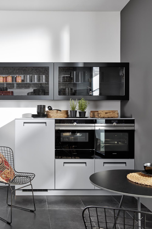 cuisine équipée moderne design avec rangement et intégration parfaite électroménager